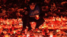 """A Romanian gendarme places candles at a memorial for the victims of the fire at the """"Colectiv"""" night. - Provided by AFP Two Men, Bucharest, Embedded Image Permalink, Night Club, Thinking Of You, Around The Worlds, Hero, Memories, Guys"""