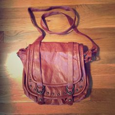 Aldo Crossbody Purse Cognac colored with brass stones and buckles  on the front. Leather , excellent condition inside is perfect. Spacious bag, roomy but smaller then a messenger. Very cute!! ALDO Bags Crossbody Bags