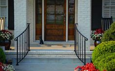 Stair Hand Rails for Porches and Decks Hand rails don't have to be perpendicular to your porch either! Curving wrought iron hand rails open up the entrance giving it a more spacious look. Wrought Iron Porch Railings, Porch Handrails, Exterior Handrail, Outdoor Stair Railing, Front Porch Railings, Front Porch Steps, Iron Handrails, Porch Stairs, Front Stairs