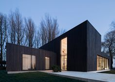 """""""We wanted the wood to appear as natural as possible, so leaving the larch untreated was the first choice,"""" Bas explained. But the shape of the house would make the wood turn gray unevenly, so they blackened the larch. """"The clients were excited with the dark color as it helps the house blend into the trees. They didn't want the anything excessive or showy."""" But blackened timber comes with its own challenges. Since it absorbs more heat, a larger air cavity was built behind the wood to keep…"""