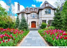 $3.8M for this extraordinary stone-and-brick manor is a stunning example of Old World craftsmanship fused with state-of-the-art technology. The sprawling six-bedroom New Traditional beauty offers soaring ceilings, custom millwork and high-end finishes throughout its four levels.