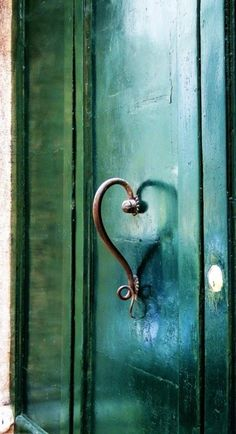 This reminds me of Jesus stands at the door waiting for it to be opened by us... There is no doorknob and the handle is shaped like a heart... Jesus desires to come and live in your heart  and soul. <3