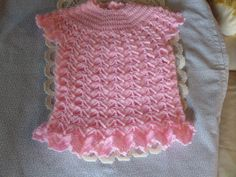 "A pretty pink baby dress. Hand crochet in 4 ply yarn. fits 3 months to 12 months. hand made in a delicate shell pattern. frilled bottom hem length 13 "" chest 51 cms machine washable acrylic yarn can be made in any colour and larger sizes Toddler Dress, Baby Dress, Pink Dress, Hand Crochet, Crochet Baby, 4 Ply Yarn, Handmade Crafts, 12 Months, Dress Making"