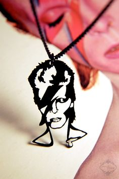 David Bowie Ziggy Stardust homage necklace in black stainless steel - glam musician jewelry. $32.00, via Etsy.