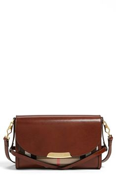 Gorgeous! Check out the bridle and saddle inspired detail on this Burberry crossbody.