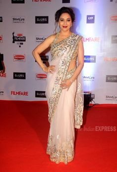 Madhuri Dixit in a white saree by Abu Jani and Sandeep Khosla on the red carpet at the Filmfare Awards show.
