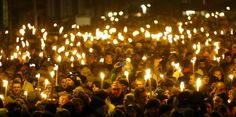 People hold candles as they attend a memorial service held for those killed by a 22-year-old gunman, in Copenhagen, Denmark February 16, 2015. REUTERS/Leonhard Foeger