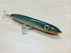 A fishing lure turned on the lathe out of maple. Airbrushed and epoxy coated.