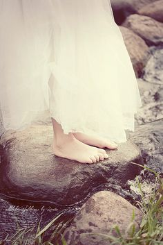 To go frolicking through a romantic forest while sunshine warms you and your bare feet tough the chilly stones of a trickling stream, and a flowly white dress wraps it's self in the wind...