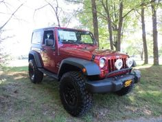 """2012 Jeep Wrangler Sport- We modified this new 2012 Jeep Wrangler with a 3"""" lift kit, a light bar with Hella fog lamps and 17"""" black wheels for your enjoyment!"""