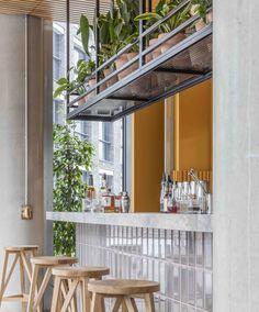 Cement greys meet bright ochre in Grzywinski + Pons' London restaurant interior Restaurant Interior Design, Cafe Interior, Restaurant Interiors, Hotel Restaurant, Counter Design, Hospitality Design, Cafe Design, Design Design, Commercial Interiors