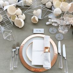 the ARK - Copper Chargers/ Lunar Snow Dinners/ Eclipse Salads / Lucite Flatware / Copper Napkin Rings / Bone Linen Crinkle Napkin