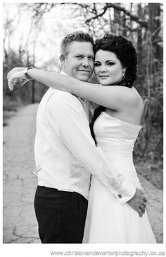 A black and white image of a couple enjoying a moment.