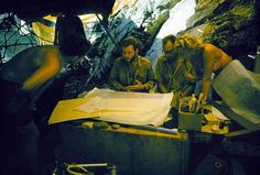 George Bass (center left) and Peter Throckmorton (center right) discuss the layout of the Cape Gelidonya wreck site.