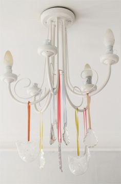Make a chandelier even more awesome and use ribbon to attach some crystals to it.