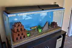 This Lego Super Mario Bros aquarium is the coolest aquarium of all time. The underwater Mario levels were always the most fun: Lego Super Mario, Super Mario Bros, Super Mario Brothers, Lego Mario, Legos, Cool Fish Tanks, Lego Room, Arcade Room, Game Room Design