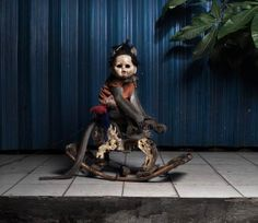 """Finnish photographer Perttu Saksa created this series of photos taken in Indonesia, titled """"A Kind of You"""", depicting Jakarta street monkeys wearing doll heads. http://kotaku.com/welcome-to-nightmares-sleepy-humans-1454596875"""