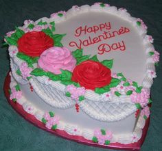 Valentine's Day Cake / Chocolate Cake iced with buttercream frosting. Buttercream roses and royal icing drop flowers.