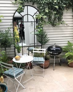 We're at a bit of a standstill in terms of big renovations, so we're looking to sort a few areas of the house that can be spruced up (relatively) cheap. # courtyard Gardening How to style small spaces: courtyard gardens Garden Spaces, Courtyard Gardens Design, Small Spaces, Outdoor Spaces, Small Backyard, Small Garden Design, Outdoor Cafe, Small Courtyards, Garden Mirrors