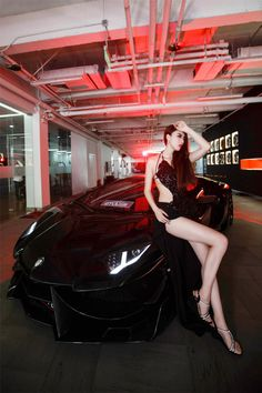 Beautiful Chinese Model and Black DMC Aventador E-GT front side