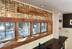 Copper panel over bar area and set of windows in renovated former carriage house.
