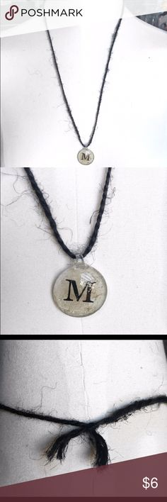 Handmade Black Twine Initial 'M' Necklace Beautiful handmade black twine necklace featuring a silver-coated beige pendant with the initial 'M' in the center. Approx. 12.5 inches, including pendant. Only one available. Handmade Jewelry Necklaces