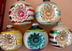 My grandmother had some ornaments like these! I love old glass ornaments and pretty balls!
