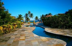 """Nestled in your Belize luxury villa rental, surrounded by turquoise-green seas and lush emerald forests, you'll understand why locals refer to Belize as """"the jewel."""""""