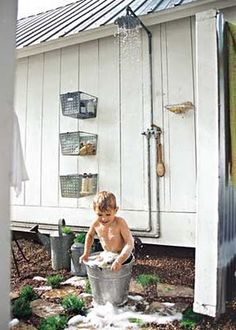 I like the baskets hanging on the wall. Good idea for the side of the garden shed. Outdoor shower is great for camping parties and the dog.