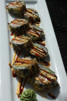 By Kelly Hickey, Assistant Photo Editor, The Daily Illini    Pictured above is the Big Roll, a tempura fried roll wrapped in seaweed that contains rice, tamago, crabmeat, avocado and cream cheese.  This popular sushi dish is from KoFusion, a contemporary American and Asian restaurant.