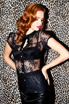 Channel Elizabeth Taylor in this eloquently sheer lace blouse. Cap sleeves and full collar constructed in jet black lace with floral motifs. Vintage crystal buttons at center front and a smooth swiss black velvet bow at collar. Style with this season's Ponti Peekaboo Pencil Skirt for a truely fem fatale look. #NicheFashion
