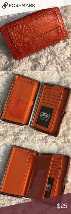 """8️⃣H A N A N E L  WALLET H A N A N E L  WALLET  Perfect wallet for the gal on the go!  Colorful, compact and convenient. Sturdy metal frame with easy-open clasp. Multi-function interior accommodates ID photo window, credit card slots, cash, checkbook holder!    ⚜️Measurements are 7.5"""" length x 1"""" width x 4.5"""" height ⚜️Sleek, unique & chic wallet ⚜️Opens easily & lies flat to allow easy access ⚜️Zippered pouch ⚜️Pocket on the back of wallet ⚜️Bonus checkbook cover included Bags Wallets"""