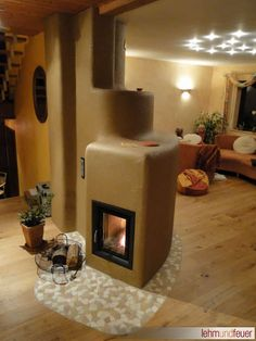 Lehm und Feuer Clay Ovens by Clay & Fire lehmundfeuer.de Batch Rocket Stove Mass Heater Similar mass heating characteristics to masonry heaters