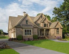 The Rochelle Plan 1204 www.dongardner.com - Old-World style meets modern-day comfort in this gorgeous design. Stone and stucco create quite the exterior, while an efficient and elegant interior is every family's dream. #Gable #House #Home