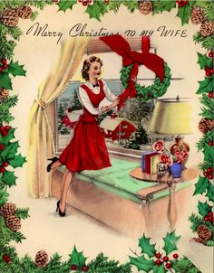 1940s wife decorating for Christmas.