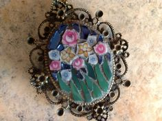 The flowers are from broken porcelain, and the rest is stained glass.  The pendant is 2.5 X2, with a 24 ball chain.  I think I finally found a way to use scraps.....without making more scraps!  Ill be making a bunch of these.  I dont plan anything ahead when Im making these, and Im having soooo much fun.