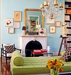 pale blue salon, with small frame art flanking the mirror/fireplace