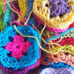 Lots of tiny mini granny squares with end to be darned in.