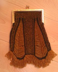 Bead knitted purse in brassy gold and black.  For sale at One Lupine Fiber, Bangor, ME