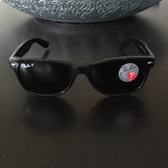 Ray-ban New Wayfarer in black NWT black on black polarized new wayfarer style sunglasses. Includes new case, new cleaning cloth, all new tags and box. Box is slightly torn from being unwrapped as they were given as a present. Ray-Ban Accessories Sunglasses