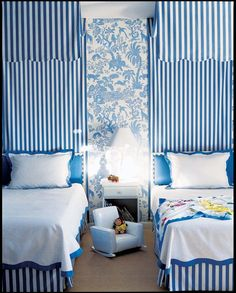 vertical line sin a room | The blue vertical lines v.s. the animal & tree wallpaper at center