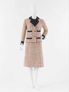 """Suit Design House: House of Chanel (French, founded 1913) Designer: Gabrielle """"Coco"""" Chanel (French, Saumur 1883–1971 Paris) Date: ca. 1958 Culture: French Medium: a) wool, silk, metal; b) wool, silk"""