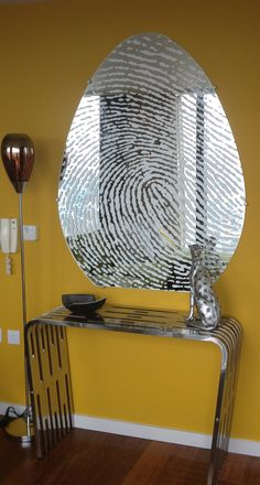 Bespoke mirror, its as unique as the finger print itself.