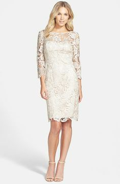 This Adrianna Papell Lace Overlay Sheath Dress is knee length with 3/4 length sleeves. So glam and elegant!