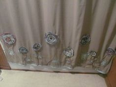Jazzing up a shower curtain with fabric flowers tutorial from Stacey Makes Cents.