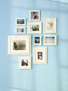 Painting photo frames a uniform color and arranging with vertical and horizontal variety creates a clean look for a busy wall.