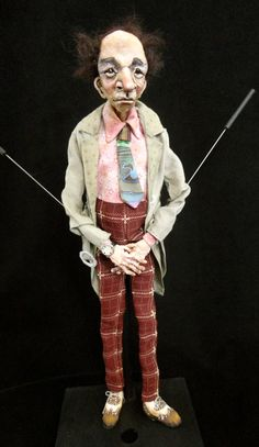 puppet with trench coat and tie