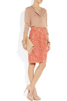 Moschino lace pencil skirt paired with a nude top