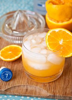 The Orange Crush (2 oranges, juiced 1.5 oz vodka 1 oz orange liqueur splash of lemon-lime soda ice)