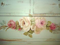 Close-up detail of a vintage dresser painted by Cindy Ellis.